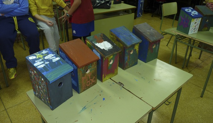 Several nest boxes, painted by kids.